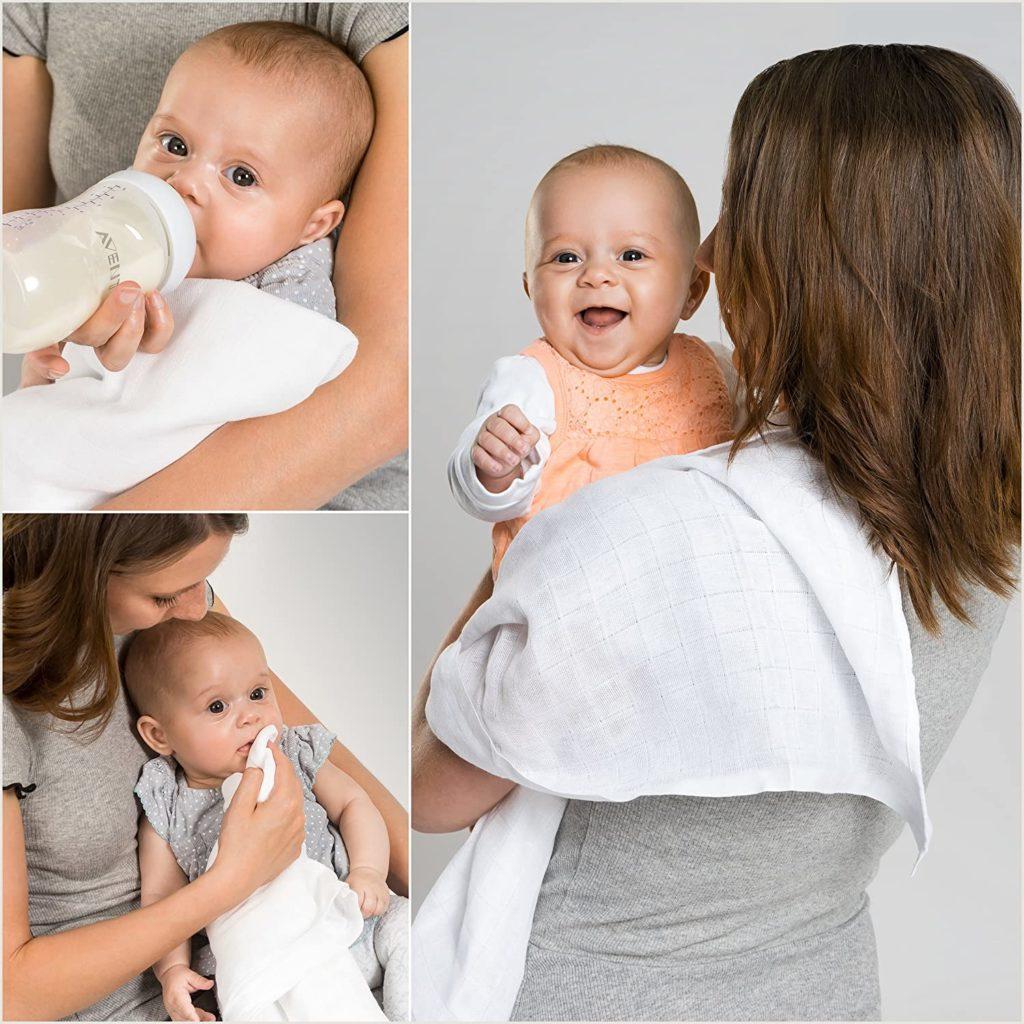 Baby in Mullwindel auf Arm von Frau